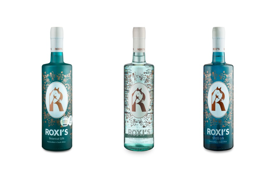 The Collection of Roxis Gin, Roxis Botanical Gin, Roxis Spice Gin and Roxis Vine Blossom Gin.